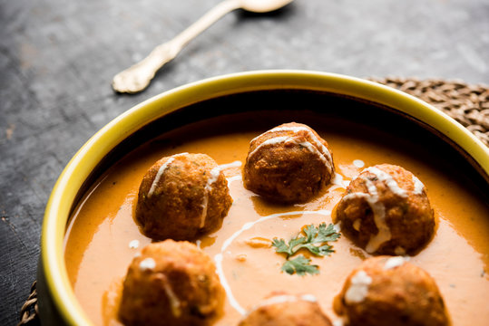Malai Kofta Curry is a Mughlai special recipe served in a bowl. Selective focus