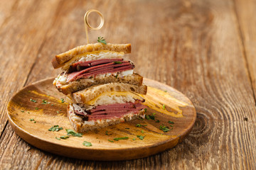 Ruben sandwich. New York sandwich with pastrami, sauce 1000 islands and sauerkraut.