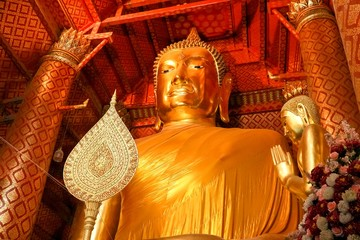 golden buddha statue at old temple in thailand.