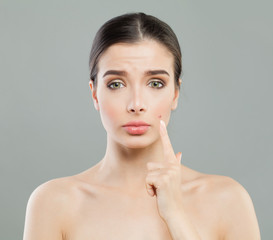 Young woman with acne pimple. Female skin problem. Facial treatment, cosmetology and skincare concept