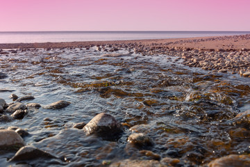 Small creek on Baltic sea beach.