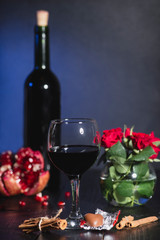 Red wine in a glass. Romantic evening with a glass of wine to Valentine's day.Holiday composition on a black table  and  background.