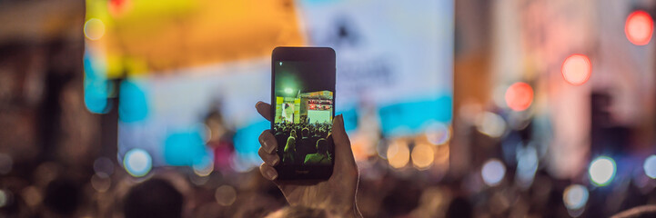 Use advanced mobile recording, fun concerts and beautiful lighting, Candid image of crowd at rock concert, Enjoy the use of mobile photography BANNER, LONG FORMAT