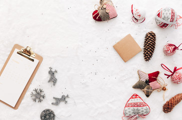 Christmas decorations over white background. Flat lay, top view