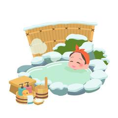 温泉につかる女性 冬