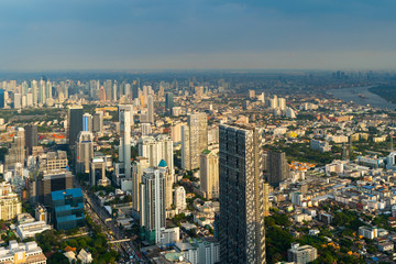 Aerial view of Sathorn, Bangkok Downtown. Financial district and business centers in smart urban city in Asia. Skyscraper and high-rise buildings.