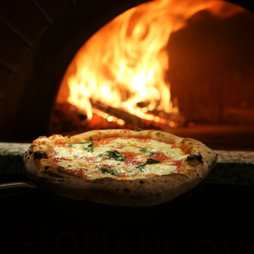 Margherita pizza near the stove