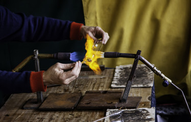 Blowing glass with fire