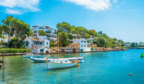 Wall mural Landscape with boat and Cala D'or village, Palma Mallorca Island, Spain