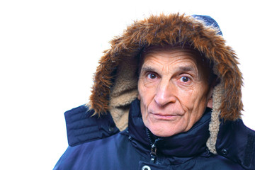 senior man in a blue warm winter jacket, hood with natural fur on his head, isolated on white background