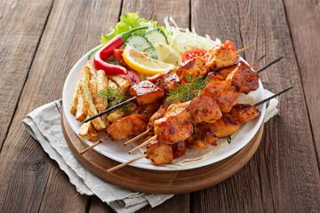 Chicken Shish kebab or shashlik, grilled meat skewers, traditional turkish dish, top view.