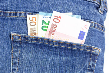 Money in the jeans pocket. Euro currency macro photo.