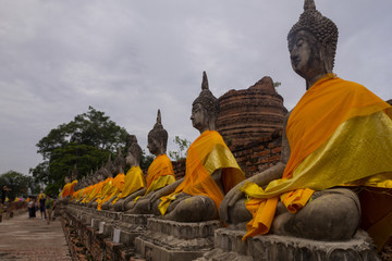 Old Ancient Temple. Rows of Buddha Images around the central stupa at the Wat Yai Chai Mongkol temple in Ayutthaya, Thailand.