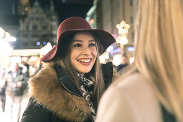 Happy women meeting and chatting at Christmas market in Munich