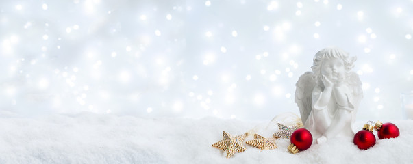 White christmas - cute angel in snow, bokeh lights in background banner