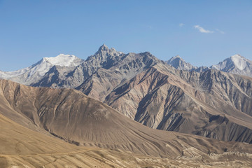 Beautiful landscape in the Pamir mountains. View from Tajikistan towards Afghanistan in the background with the mountain peaks