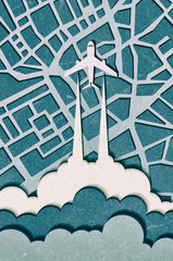 Airplane in the clouds flying over the city. Vibrant multicolored paper cut background. Abstract modern 3d origami paper art style