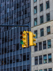 Fototapete - Traffic light in the background of skyscrapers. New York