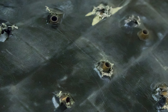 army background. Bulletproof test armor protection armor assault rifles stuck in the plate base grunge