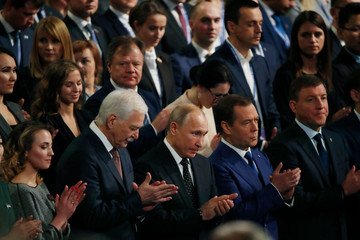 Gryzlov, Russian President Putin, Prime Minister Medvedev and Turchak applaud during the United Russia political party annual convention in Moscow