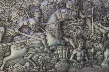 Thai style silver carving art on temple wall , Wat Srisuphan ,Chiang Mai, Thailand.