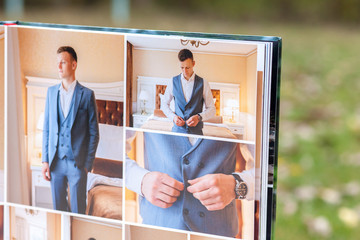 Pages of wedding photobook or wedding album on green background
