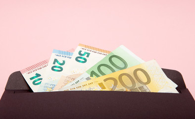 Set of euro in black envelope on pink background. Business Concept and Instagram