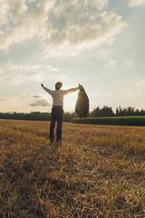 Businessman celebrating his achievement outside in autumn field