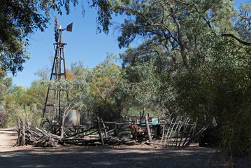 Setting mimicking a farm in the Australian outback with windmill