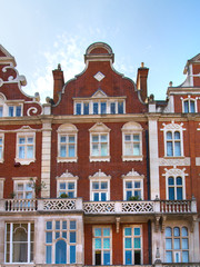 London, UK. Residential area of Kensington and Chelsea. Row of periodic buildings.