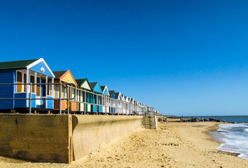 Multi coloured beach huts sea front Southwold Norfolk UK