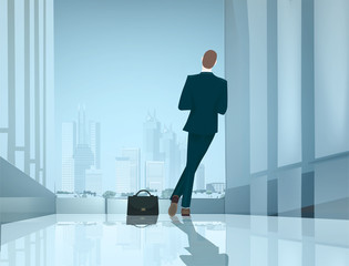 Businessman in the office leaned against the wall and looking over the city