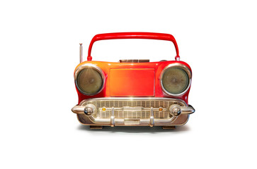 Old antique car shape AM FM stereo cassette player isolated on white background