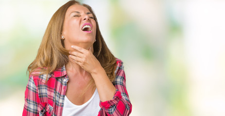 Beautiful middle age woman wearing over isolated background Touching painful neck, sore throat for flu, clod and infection