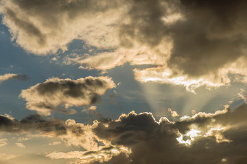 Beautiful detail of a dramatic sky in which the sun peeks through the clouds