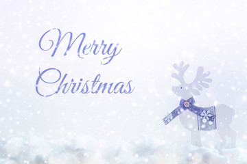 White Christmas card with snow, wooden reindeer in a scarf and Merry Christmas inscription