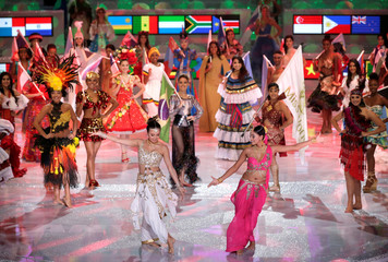 Contestants dance during the 68th Miss World pageant in Sanya