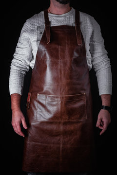 A man in a leather apron