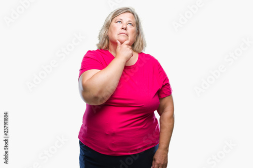 6031ba2bcf1 Senior plus size caucasian woman over isolated background with hand on chin  thinking about question