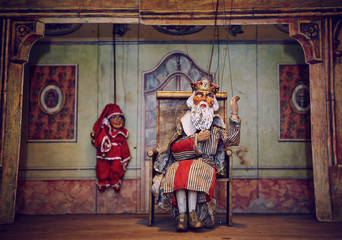 Handmade wooden puppet theater. King and Jester. Selective focus Wall mural