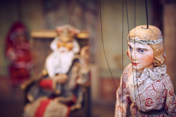 Wall Mural - Handmade wooden puppet theater. King and princess. Selective focus