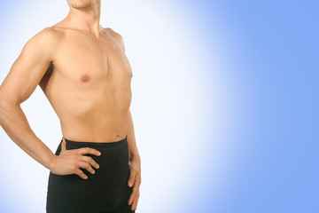 Male black thermal underwear for active winter sport. Man wearing Thermolinen on blue background. Topless, but in  leggings