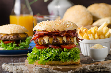 Homemade bacon burger with lettuce and cheddar