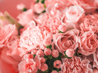 Beautiful bouquet with roses, dianthus, hypericum, clove in color of year 2019 Living Coral concept. Trendy color Living Coral in flowers, wedding bouquet. Shallow DOF.