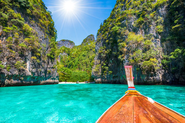 Wall Mural - Landscape with  longtail boat on Loh Samah Bay, Phi Phi island, Thailand