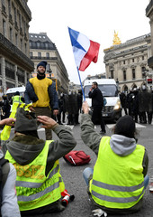 """Protesters wearing yellow vests attend a demonstration during a national day of protest by the """"yellow vests"""" movement in Paris"""