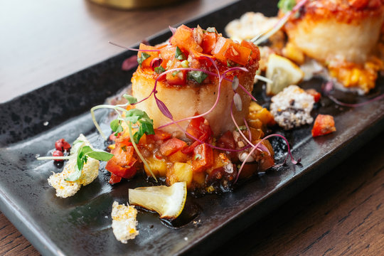 Grilled scallops with salsa lemon sweet and sour sauce.