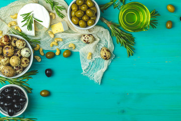 Cheese camembert, black and green olives, quail eggs, olive oil and rosemary