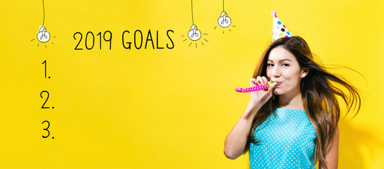 2019 goals with young woman with party theme on a yellow background