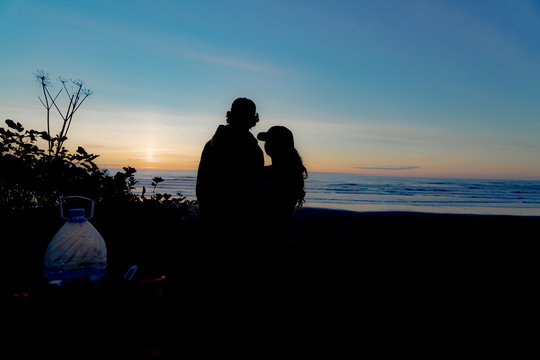 Couple siloutte at beach sunset